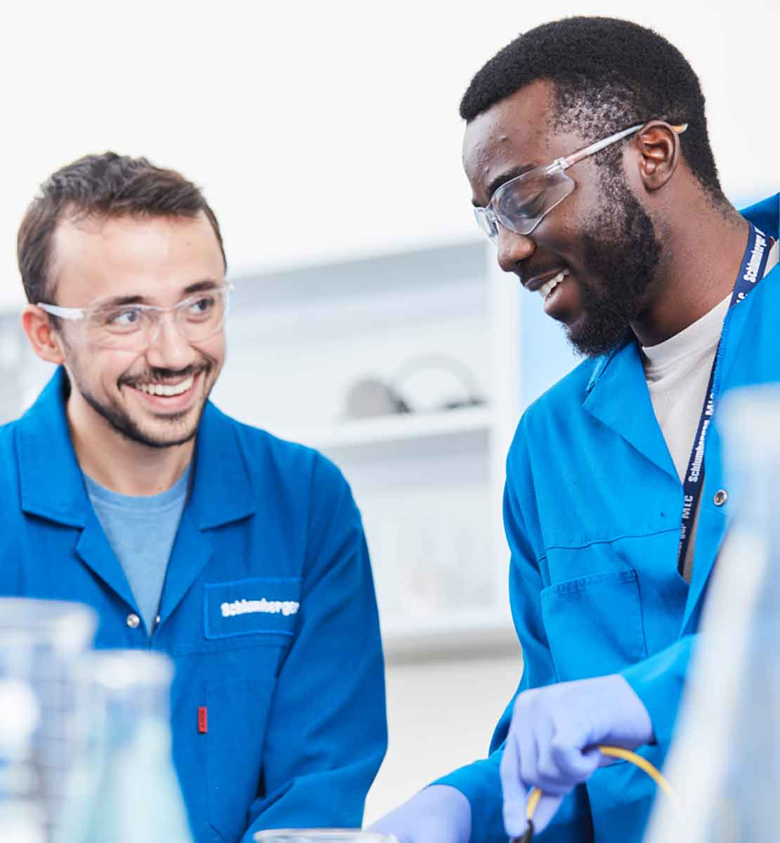 Schlumberger employees work together in lab.